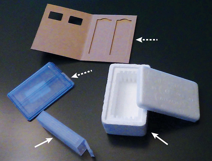 Slide holders that can be used for shipping slides. The hard-plastic box and polystyrene foam container (solid arrows) are protective enough to ship slides without additional packaging. The cardboard and soft-plastic casing (dashed arrows) need additional protection during shipping.