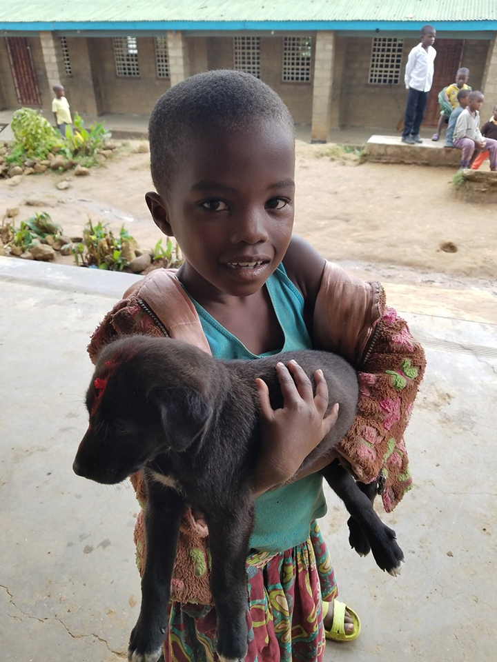 A child whose puppy was just vaccinated